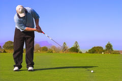 Golfer putting Stock Image