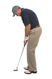 Golfer putting. Studio shot of a golfer lining up his putter Stock Image