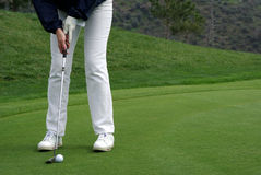 Golfer putting the ball. Up close Stock Photography