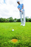 Golfer putting. Royalty Free Stock Photography