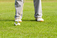 Golfer on putting gesture. Legs of golfer on putting gesture Stock Images