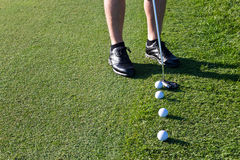 Golfer putting the golf ball Stock Images