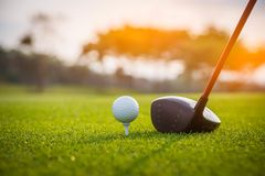Golfer is putting golf ball on green grass at golf course for training to hole  with blur background a. Nd sunlight ray stock images