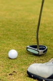 Golfer putting a golf ball Royalty Free Stock Photo