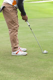 Golfer on putting green. Stock Photo