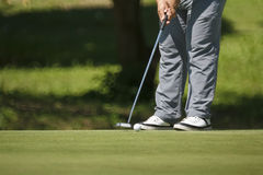 Golfer putting on green. Stock Photography