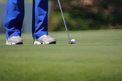Golfer putting, selective focus on golf ball Stock Images