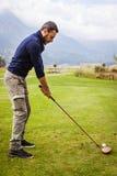 Golfer ready to hit Stock Photo