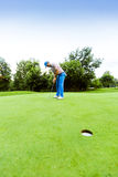 Golfer ready to take the shot Stock Photography