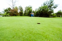 Golfer ready to take the shot. On the putting green Stock Photo