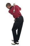 Golfer red shirt back swing Royalty Free Stock Photos