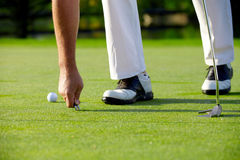 Golfer repaired green with pitch fork Royalty Free Stock Photography