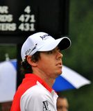 Golfer Rory McIlroy. Pro golfer Rory McIlroy watches his tee shot on the course Stock Photo