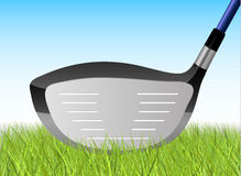 Golfer's Driver. Golf Driver Resting in blades of Grass Royalty Free Stock Photography