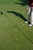 Golfer's Shadow - Vertical Stock Photo