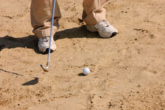 Golfer in a sandtrap Stock Images