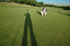 Golfer and shadow Stock Images