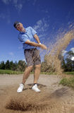 Golfer shooting a golf ball Stock Photo