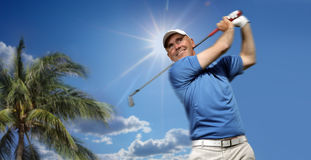 Golfer shooting a golf ball Royalty Free Stock Photography
