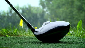 Golfer shooting a golf ball stock footage