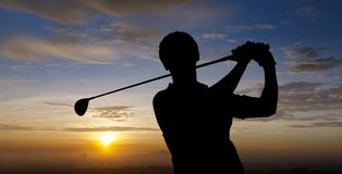 Golfer silhouette. During sunset with dramatic sky Stock Images