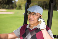 Golfer smiling and calling Royalty Free Stock Photo