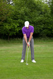 Golfer stance for a mid iron shot Stock Photos