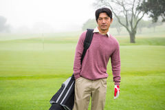 Golfer standing holding his golf bag Royalty Free Stock Image