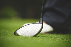 Golfer stood with a wood club Stock Image