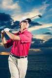 Golfer at sunset Stock Photos