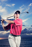 Golfer at sunset Stock Photography