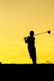 Golfer at sunset. On the orange sky Stock Photos