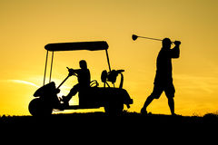 Golfer at sunset. On the orange sky Stock Photo