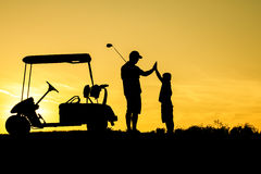 Golfer at sunset. On the orange sky Royalty Free Stock Images