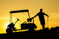 Golfer at sunset. On the orange sky Stock Photography