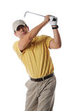 Golfer after swing. On a studio setting isolated on a white background Stock Photography