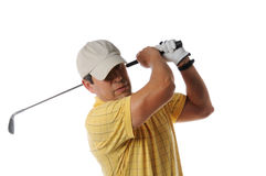Golfer after swing. On a studio setting isolated on a white background Royalty Free Stock Photos