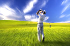 Golfer swing action Royalty Free Stock Images