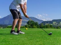 Golfer swinging driver Royalty Free Stock Image