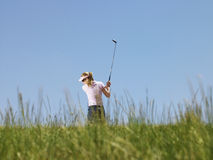 Golfer Swinging A Golf Club Stock Image