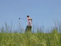 Golfer Swinging A Golf Club Royalty Free Stock Photos