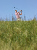 Golfer Swinging A Golf Club Royalty Free Stock Photo