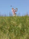 Golfer Swinging A Golf Club Royalty Free Stock Photo