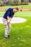 Golfer swinging Stock Photos