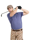 Golfer swinging his club. Photo of a male golfer in his late twenties finishing his swing with a wedge Royalty Free Stock Photos