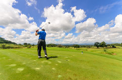 Golfer swinging his gear and hit the golf ball Stock Photography