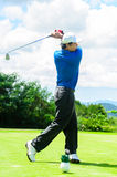 Golfer swinging his gear and hit the golf ball Stock Photo