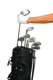 Golfer taking club from bag. Golfer removing his driver from a black golf bag. Only Golfers arm and hand with glove are showing. Isolated over a white background Royalty Free Stock Image