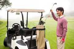 Golfer taking club in golf bag Stock Image