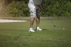 Golfer taking a shot Royalty Free Stock Images